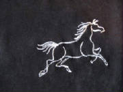 Animals/019EmbroideredWhiteHorseOnBlackDetail.jpg